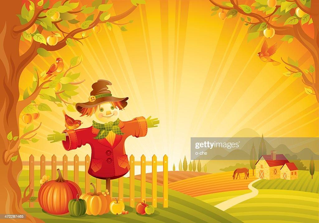 Autumn lanscape with scarecrow