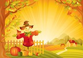 Autumn lanscape with scarecrow