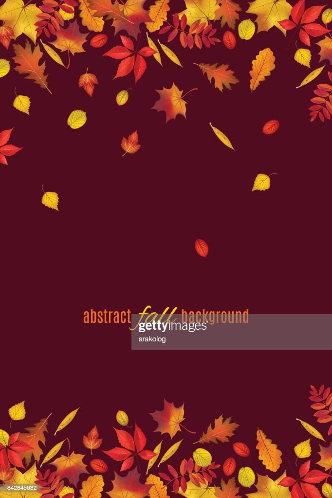 Autumn leaves isolated on dark brown background