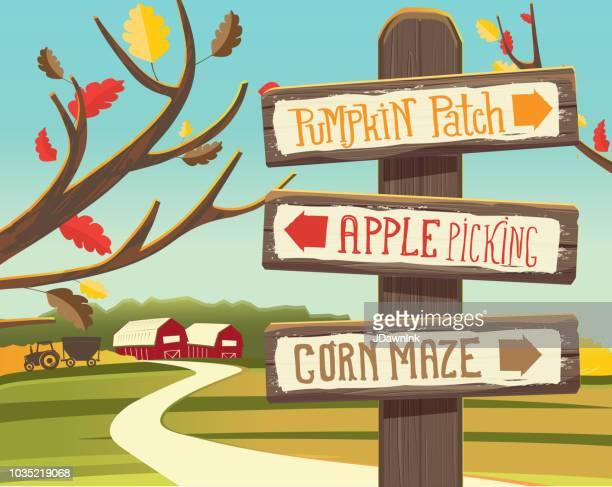 Autumn Pumpkin Patch, Apple Picking and corn maze wooden signpost