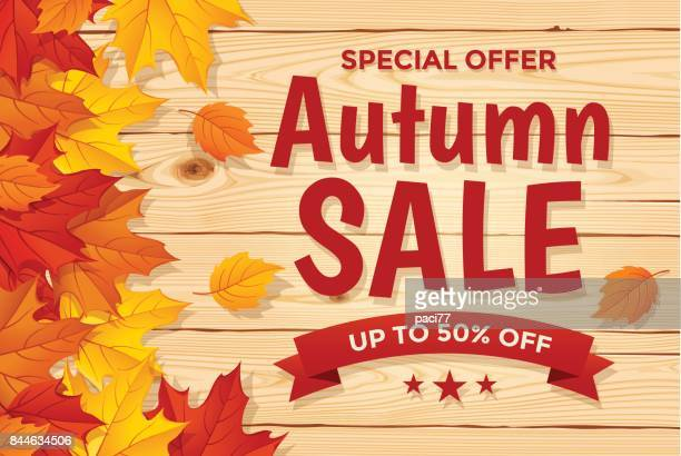 Autumn Sale on wood background with Leaf