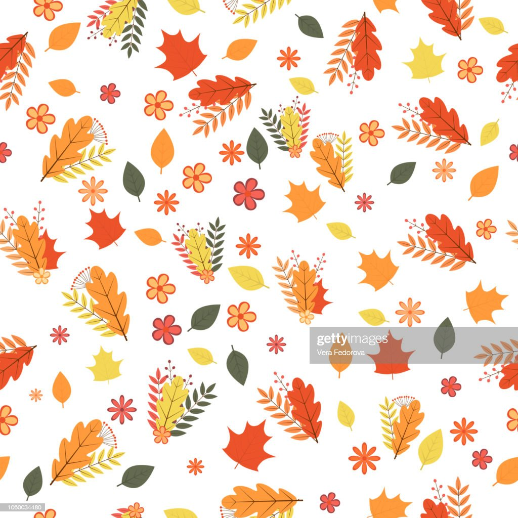 Autumn seamless pattern. Colorful leaves, flowers, and berries isolated on white. Fall theme vector illustration.