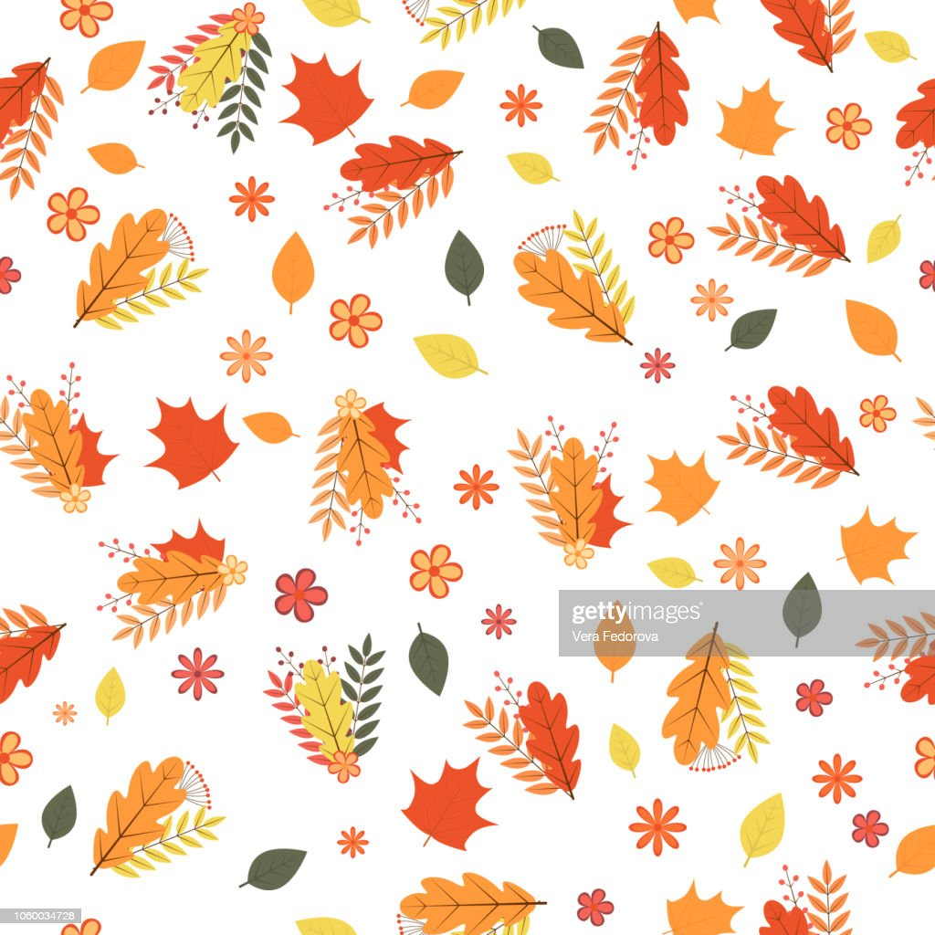 Autumn seamless pattern. Colorful leaves, flowers, and berries isolated on white. Fall theme vector illustration. Background for wedding invitation, greeting card, fabric, banner, gift wrap, etc.