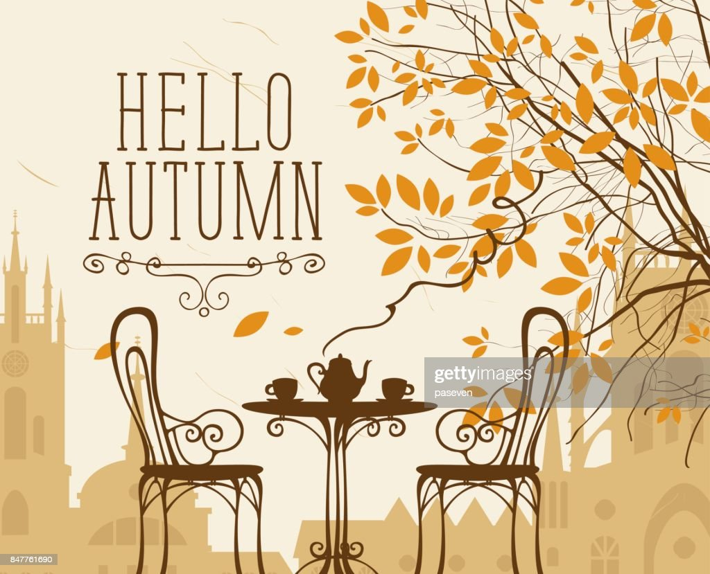 autumn urban scape with furniture of street cafe