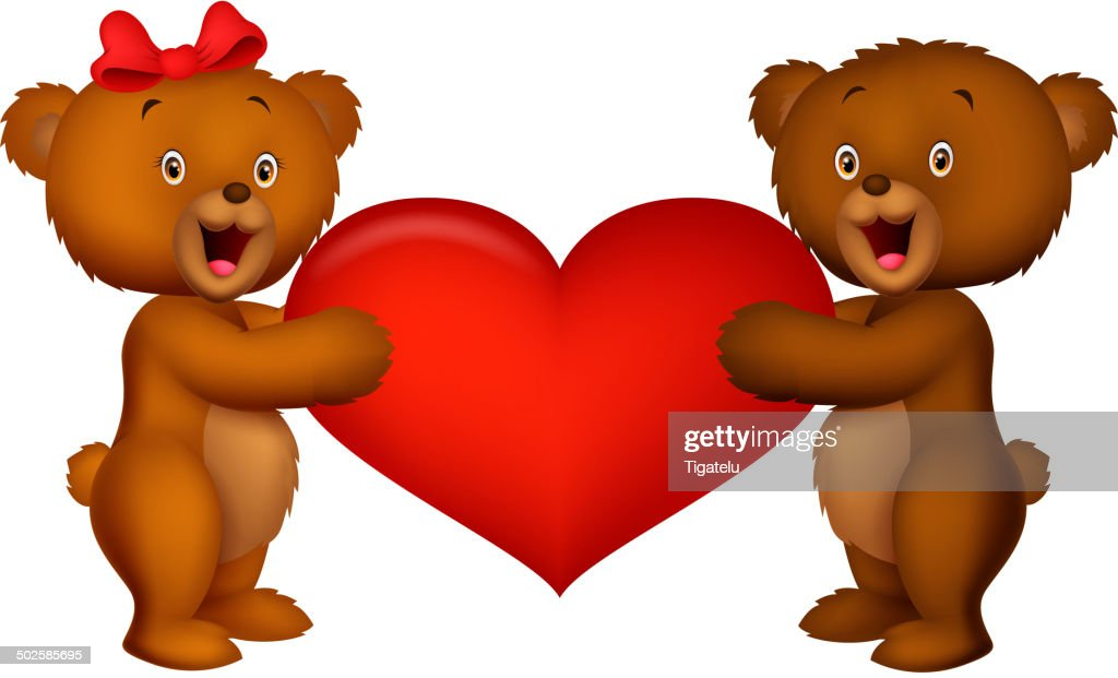 Baby bear holding red heart