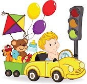baby boy by car with toys