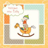 baby boy shower with wood horse toy