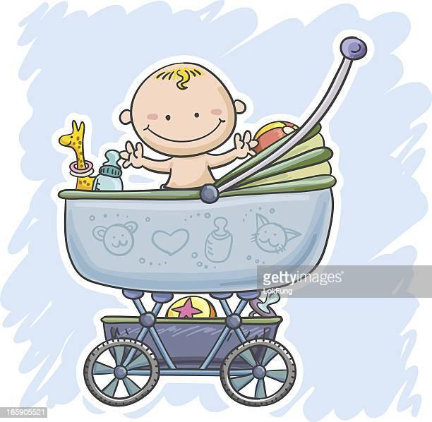 Baby boy sitting inside his stroller