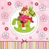 baby girl with bear on horse