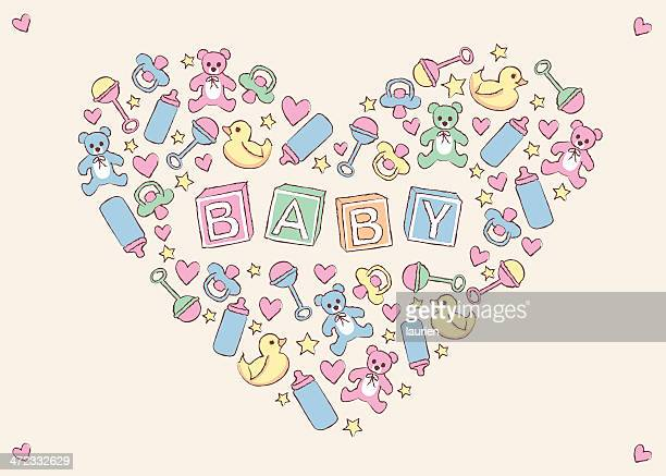 Baby items creating heart shape.