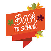 Back to school concept with ribbon banner, lettering on it and orange leaves.