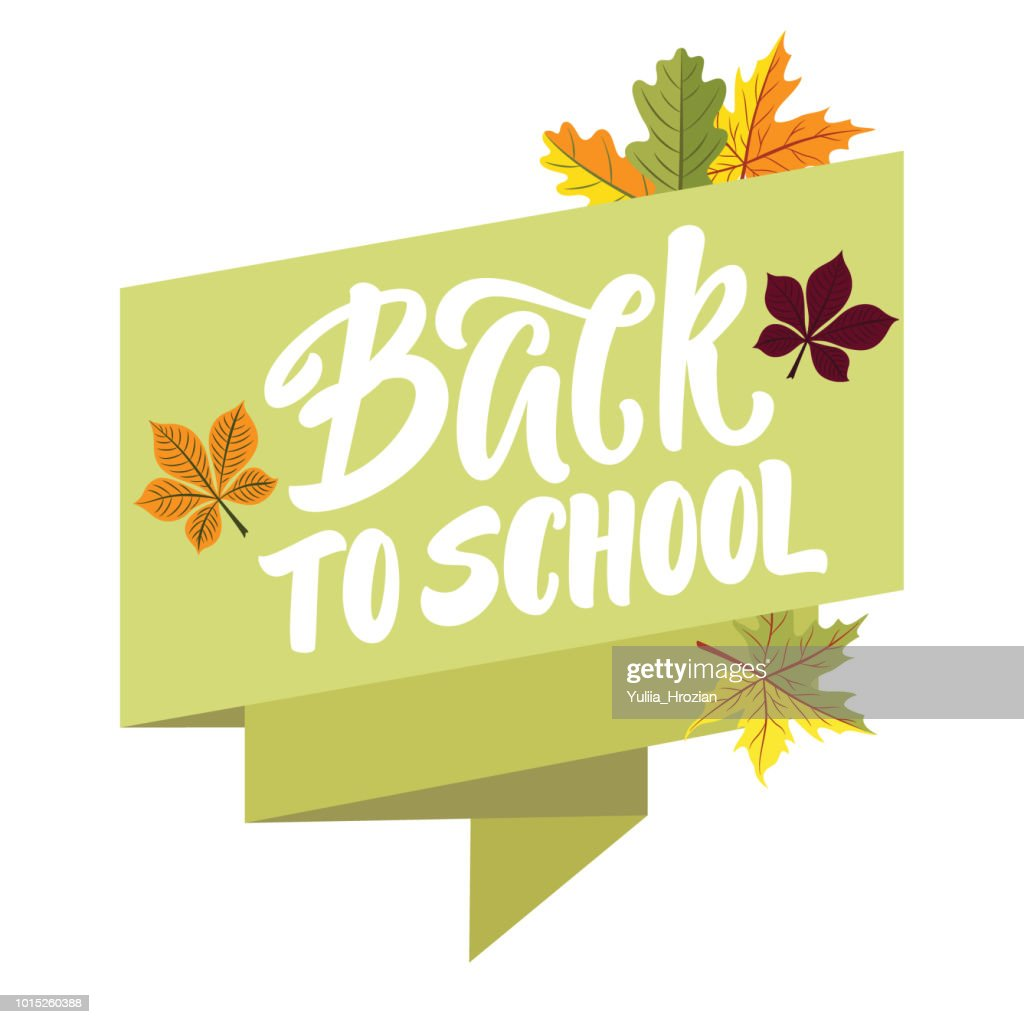 Back to school lettering on green ribbon banner with autumn leaves around.