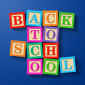 Back to School phrase compiled with wooden alphabet blocks
