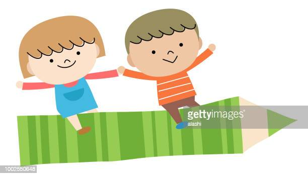 Back to school: Two children boy and girl flying with big pencil