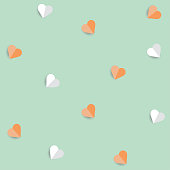 Background by many hearts vector icon, Orange and white heart on the green background