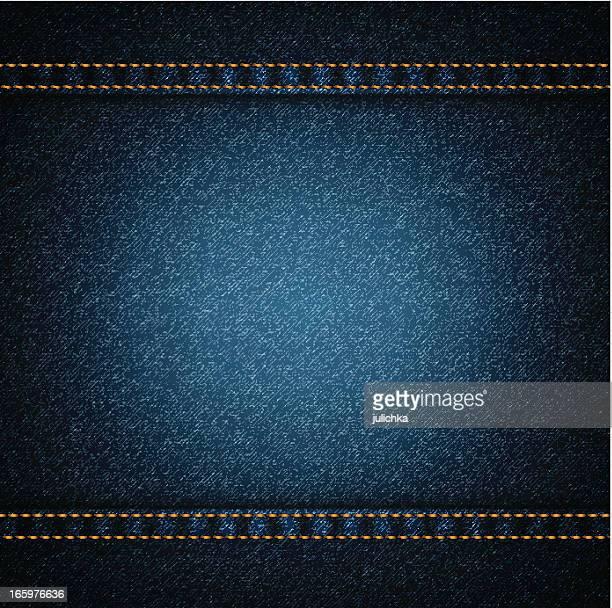 Background of dark blue denim with orange threading