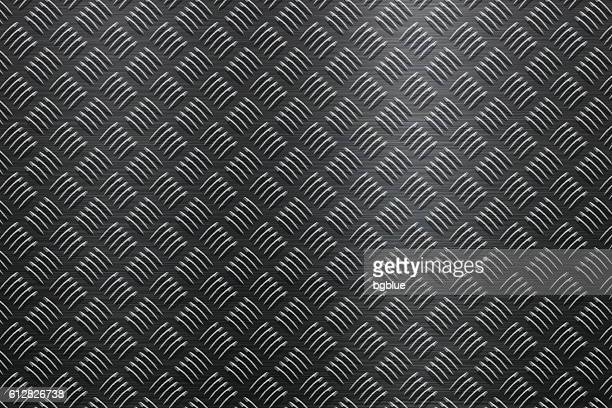 background of metal diamond plate in black color - toughness stock illustrations