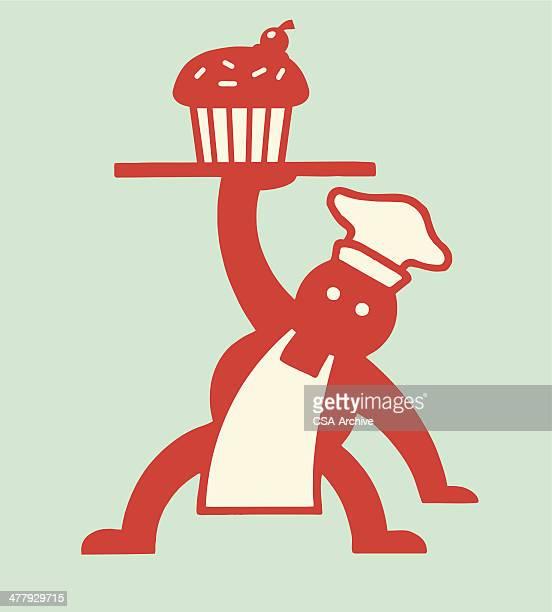 Baker Holding Cupcake