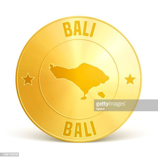 bali - gold coin on white background - bali stock illustrations