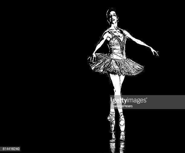 Ballerina dancing on stage. Isolated on black background
