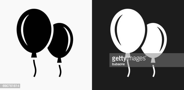 balloon icon on black and white vector backgrounds - hot air balloon stock illustrations, clip art, cartoons, & icons