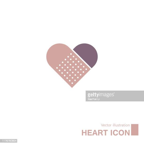 band-aid and heart-shaped symbols. - heart shape stock illustrations