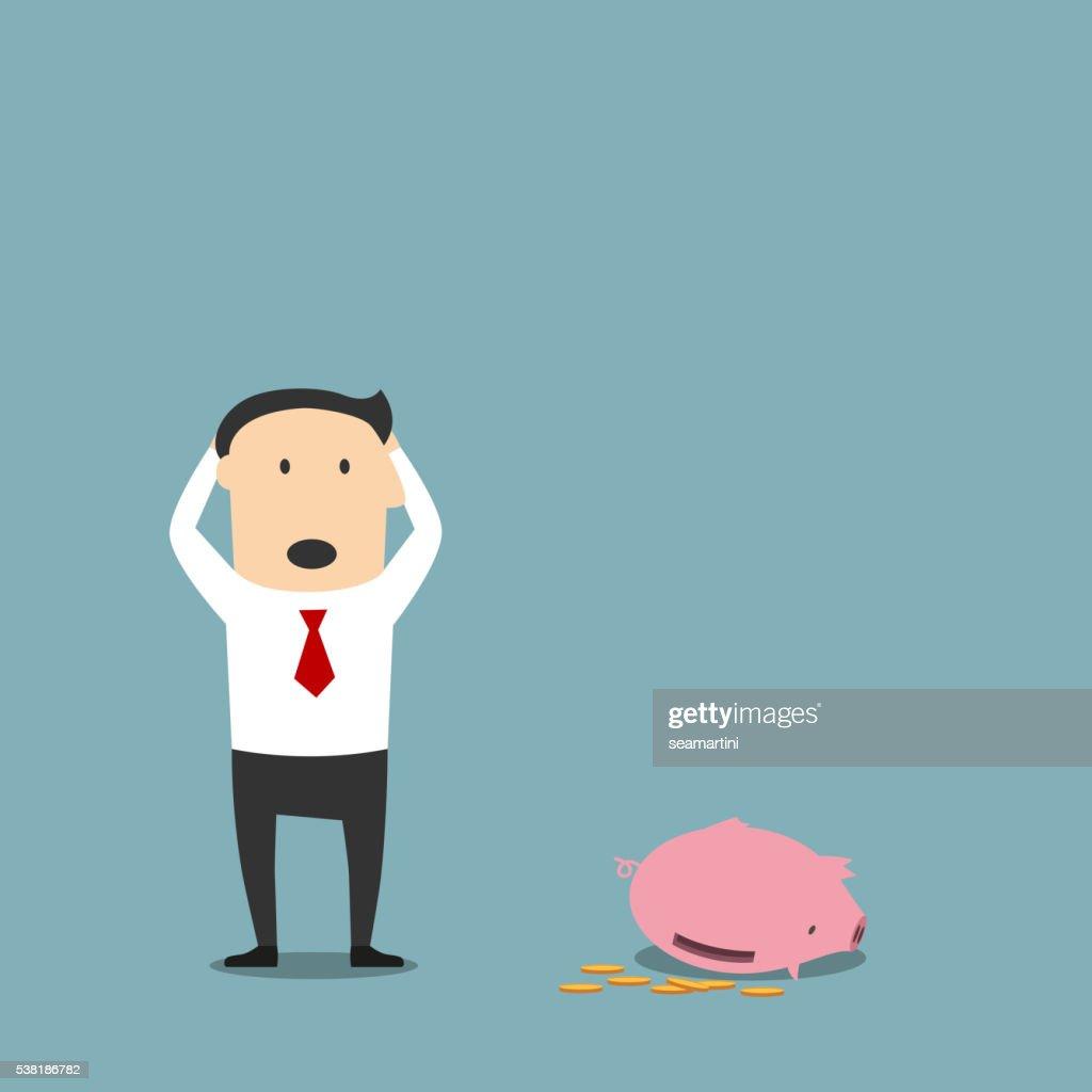 Bankrupt businessman with empty piggy bank