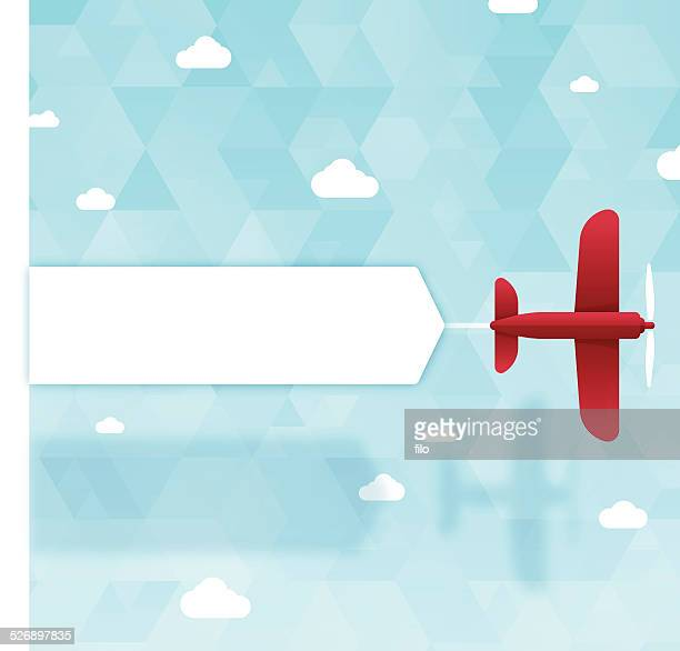 banner plane - biplane stock illustrations, clip art, cartoons, & icons