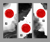 Banners with abstract black ink wash painting and red sun in East Asian style. Traditional Japanese ink painting sumi-e. Contains hieroglyph - happiness.