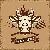 Bar and grill. Cow head with kitchen tools on grunge