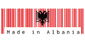 Barcode set the color of Albania flag, a red with the black double-headed eagle on white background with text: Made in Albania.