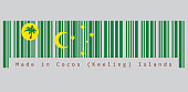 Barcode set the color of Cocos (Keeling) Islands flag, a palm tree on a gold disc, crescent and southern cross on green, text: Made in Cocos (Keeling) Islands.