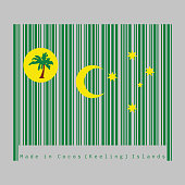 Barcode set the color of Cocos (Keeling) Islands flag, a palm tree on a gold disc, crescent and southern cross on green.