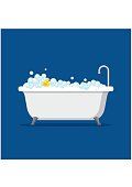 Bathtub with foam bubbles inside and bath yellow rubber duck isolated on blue background. Bath time in flat style vector illustration