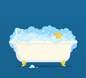 Bathtub with soap bubbles and cute duck