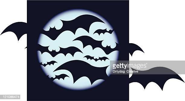 Bats against blue moon