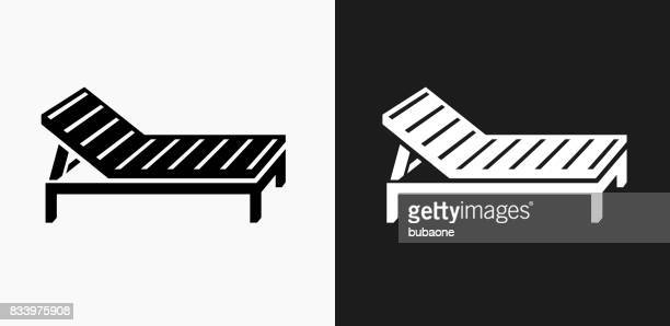 Beach Chair Icon On Black And White Vector Backgrounds