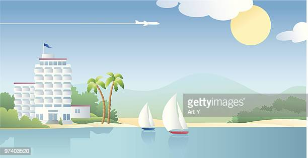 Beach Front Hotel with Sail Boats on Sunny Day