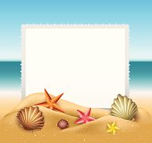 Beach text frame with shells in sand