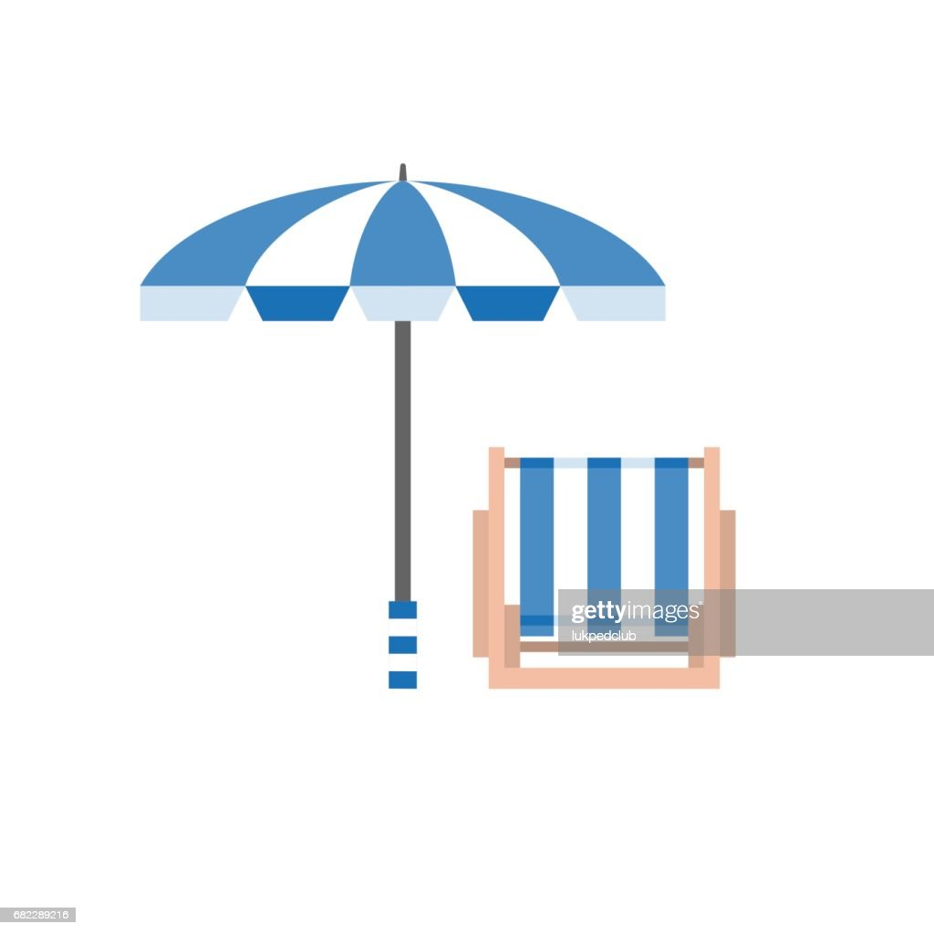 Beach umbrella and deck chair