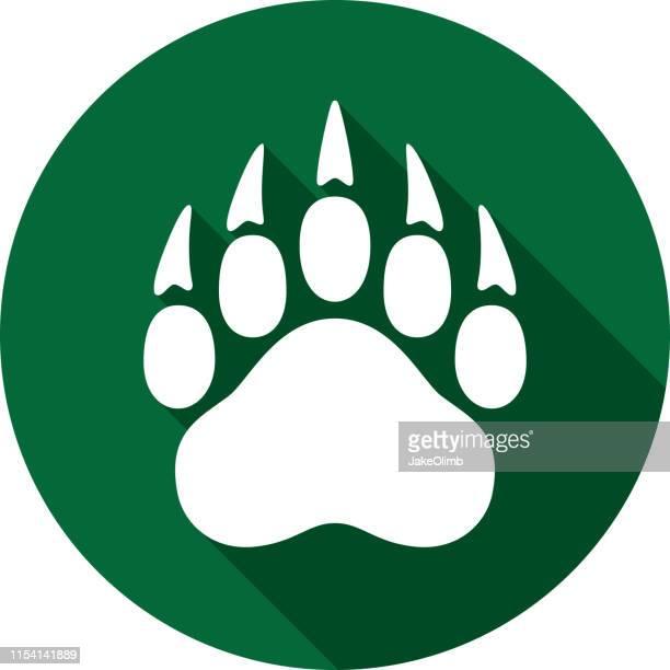 bear paw print icon silhouette - bear tracks stock illustrations