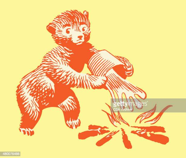 bear putting fire out - extinguishing stock illustrations