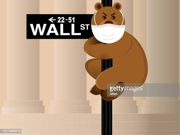 bear wearing protective mask hangs onto the wall street sign. - bear market stock illustrations