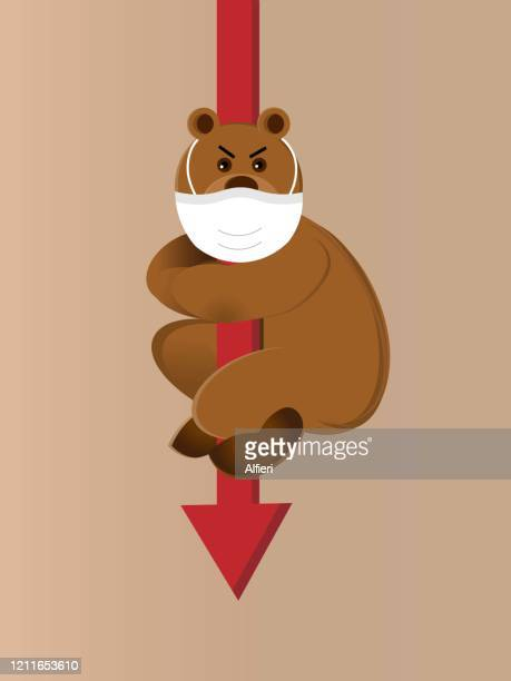 bear wearing protective mask is holding onto an arrow which is going down - bear market stock illustrations