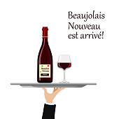 Beaujolais Nouveau wine with glass on tray