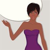 Beautiful african american woman standing near blank speech bubble