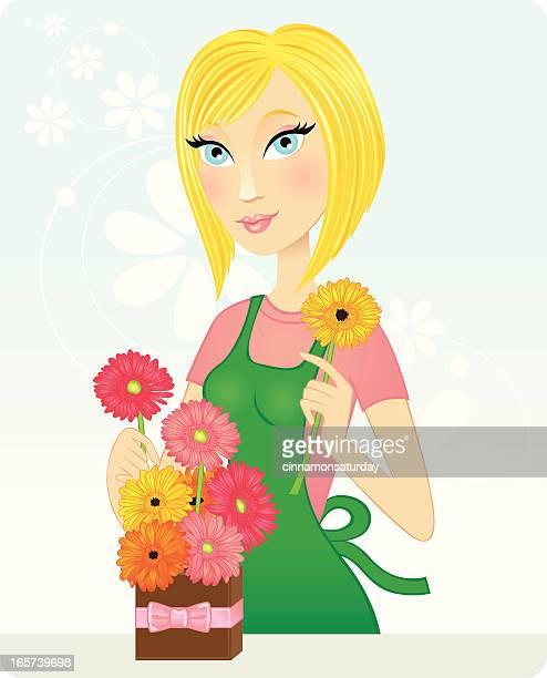 Beautiful blond florist arranging gerbera daisies