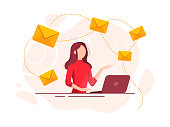 Beautiful cheerful young businesswoman working on laptop. E-mail and communication concept.