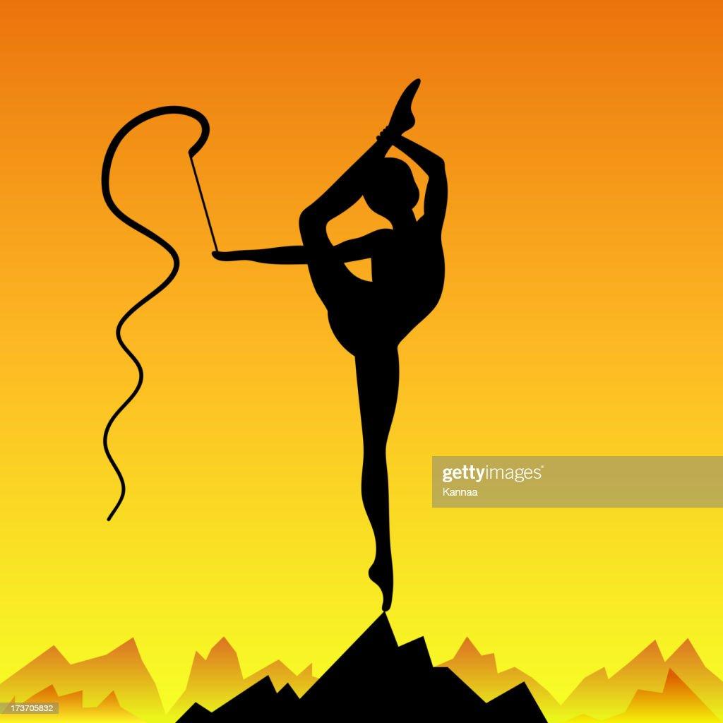 Beautiful flexible girl gymnast staying on one leg