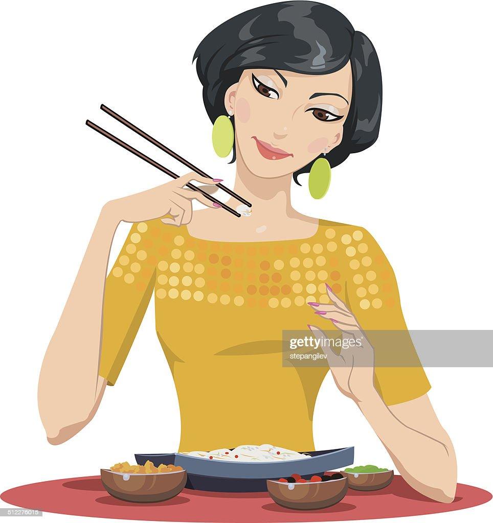 beautiful girl eats with chopsticks